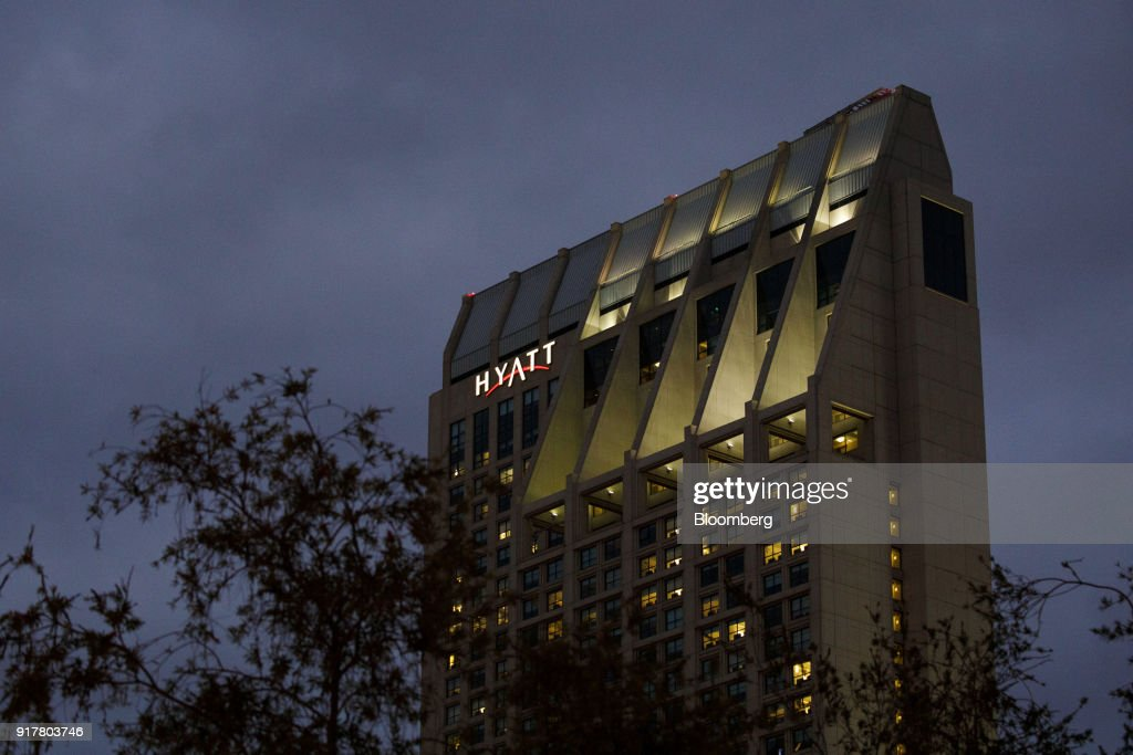 Signage is displayed on the exterior of the Manchester Grand Hyatt Hotel at night in San Diego, California, U.S., on Sunday, Feb. 11, 2018. Hyatt Hotels Corp. is scheduled to release earnings figures on February 14. Photographer: Patrick T. Fallon/Bloomberg via Getty Images