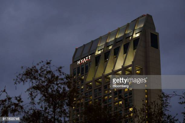 Signage is displayed on the exterior of the Manchester Grand Hyatt Hotel at night in San Diego California US on Sunday Feb 11 2018 Hyatt Hotels Corp...