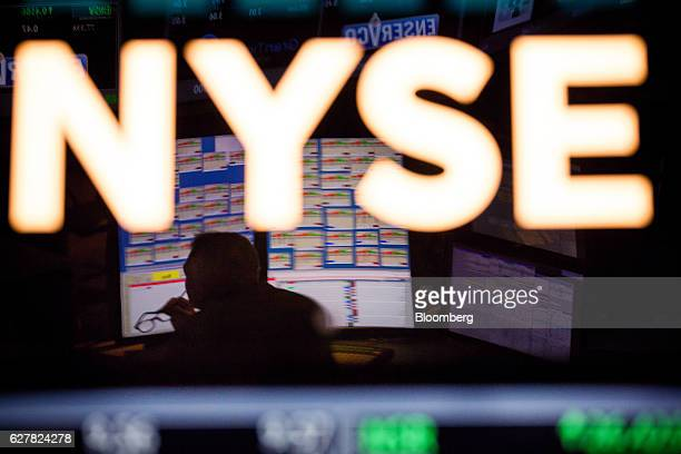 Signage is displayed on the floor of the New York Stock Exchange in New York US on Monday Dec 5 2016 US stocks climbed reversing a brief dip in early...