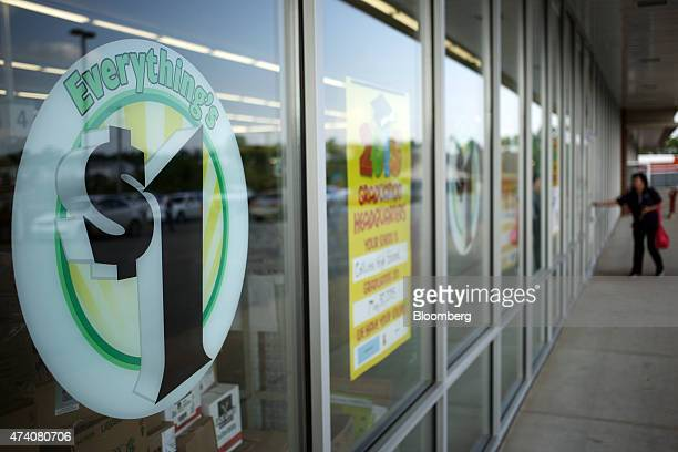 Signage is displayed on the front windows of a Dollar Tree Inc store in Shelbyville Kentucky US on Friday May 15 2015 Dollar Tree is expected to...