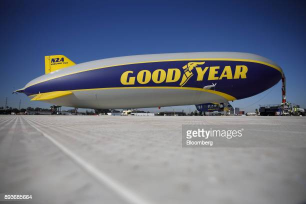 Signage is displayed on the Goodyear Tire Rubber Co Wingfoot Two blimp at the company's airship base in Carson California US on Friday Dec 15 2017...