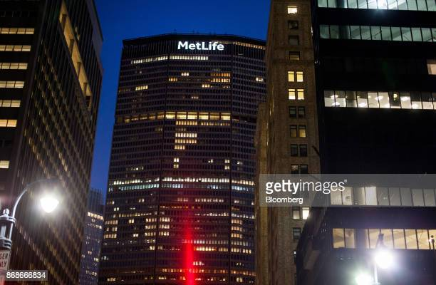 Signage is displayed on the MetLife Building at dawn in New York, U.S., on Tuesday, Oct. 31, 2017. MetLife Inc. Is scheduled to release earnings...