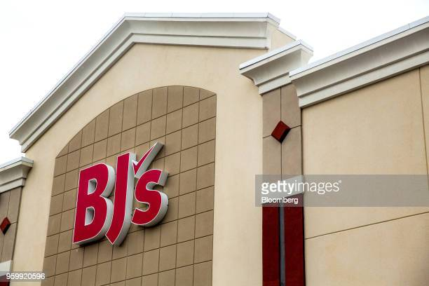 Signage is displayed outside a BJ's Wholesale Club Holdings Inc location in Miami Florida US on Thursday May 17 2018 The warehouseclub chain which...