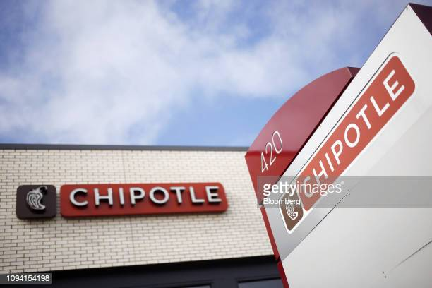 Signage is displayed outside a Chipotle Mexican Grill Inc restaurant in Louisville Kentucky US on Saturday Feb 2 2019 Chipotle Mexican Grill Inc is...