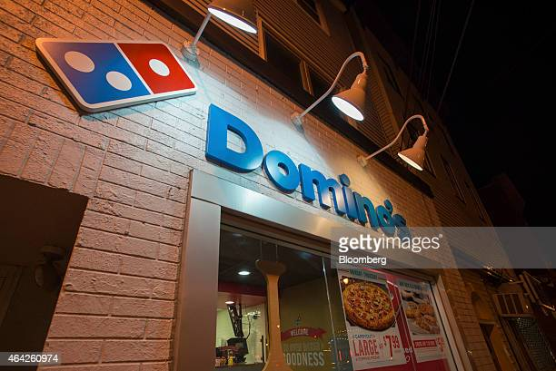 Signage is displayed outside a Domino's Pizza Inc 'pizza theater' location in Jersey City New Jersey US on Friday Feb 20 2015 Domino's which is...