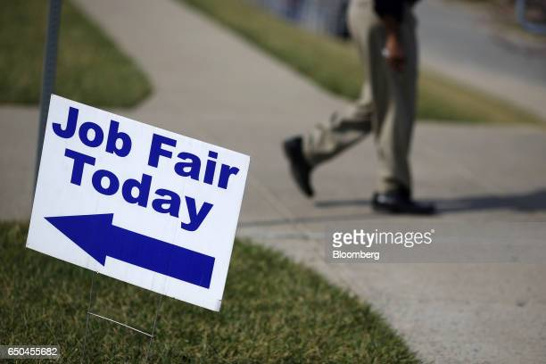 Signage is displayed outside a Job News USA career fair in Overland Park Kansas US on Wednesday March 8 2017 Applications for US jobless benefits...