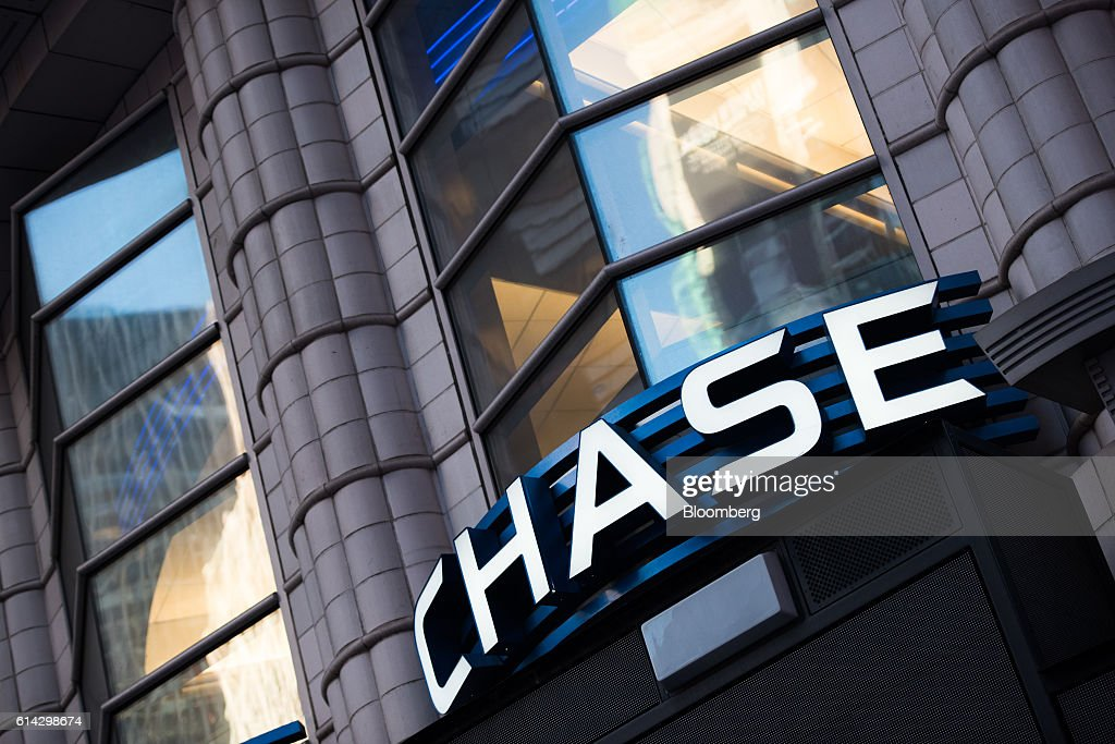 Signage is displayed outside a JPMorgan Chase & Co. bank branch in New York, U.S., on Friday, Oct. 7, 2016. JPMorgan Chase & Co. is scheduled to release earnings figures on October 14. Photographer: Mark Kauzlarich/Bloomberg via Getty Images