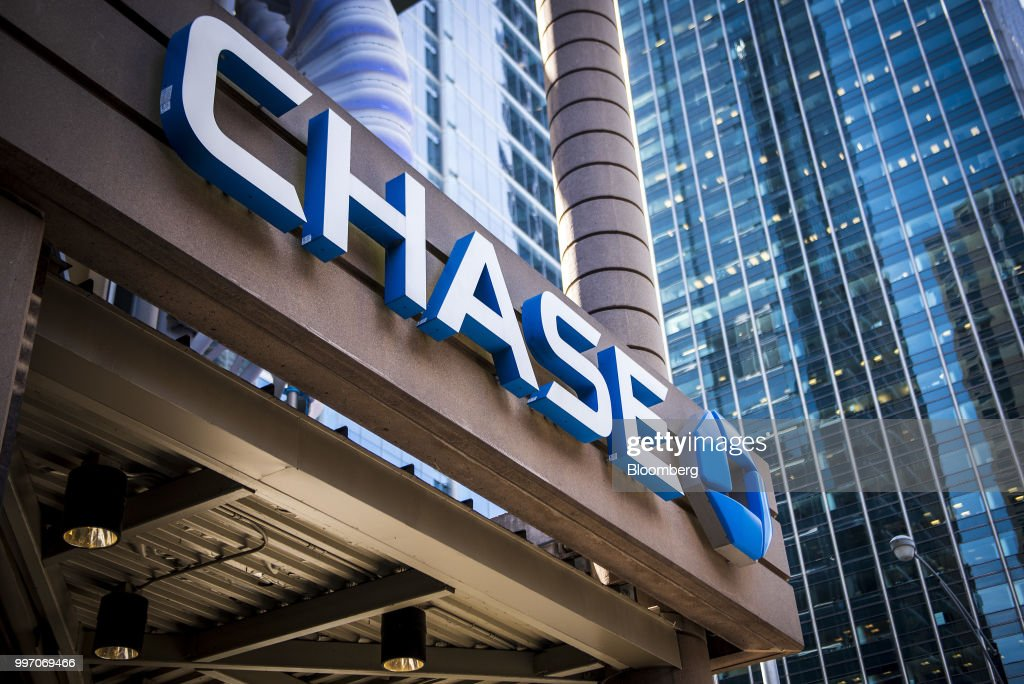 Signage is displayed outside a JPMorgan Chase & Co. bank branch stands in Chicago, Illinois, U.S., on Tuesday, July 10, 2017. JPMorgan Chase & Co. is scheduled to release earnings figures on July 13. Photographer: Christopher Dilts/Bloomberg via Getty Images