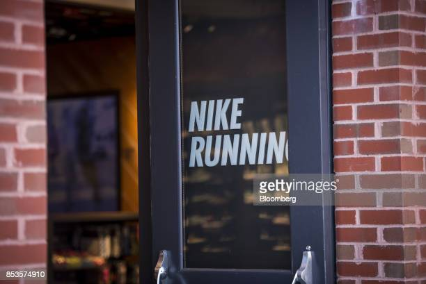 Signage Is Displayed Outside A Nike Inc Running Store In Chicago Illinois US On Sunday Sept