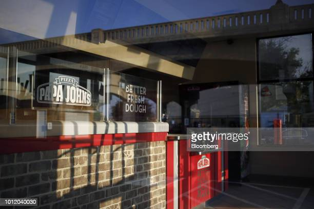 Signage is displayed outside a Papa John's International Inc pizza restaurant in Louisville Kentucky US on Friday Aug 3 2018 Papa John's...