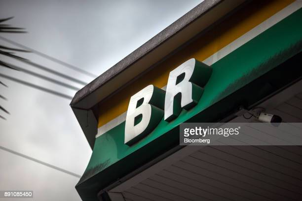 Signage is displayed outside a Petrobras Distribuidora SA gas station in Sao Paulo Brazil on Monday Dec 11 2017 Petroleo Brasileiro SA  is getting...