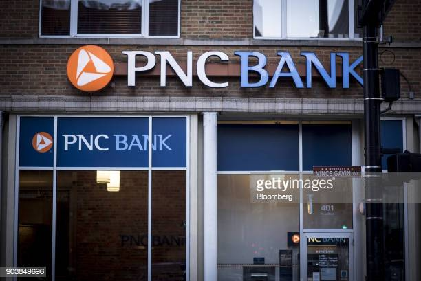 Signage is displayed outside a PNC Financial Services Group Inc bank branch in downtown Chicago Illinois US on Monday Jan 8 2018 PNC Financial...