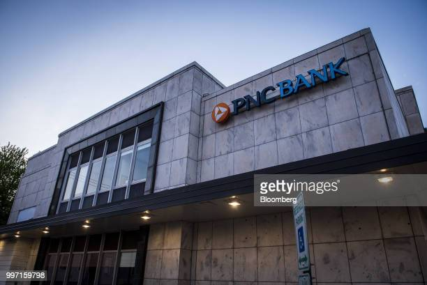 Signage is displayed outside a PNC Financial Services Group Inc bank branch in Chicago Illinois US on Tuesday July 10 2018 PNC Financial Services...