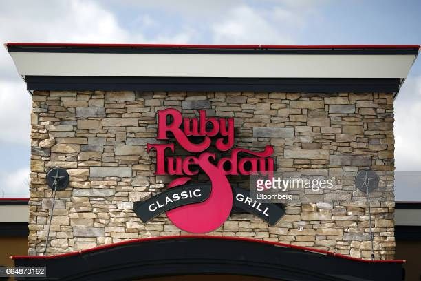 Signage is displayed outside a Ruby Tuesday Inc restaurant in Bowling Green Kentucky US on Tuesday April 4 2017 Ruby Tuesday Inc is scheduled to...