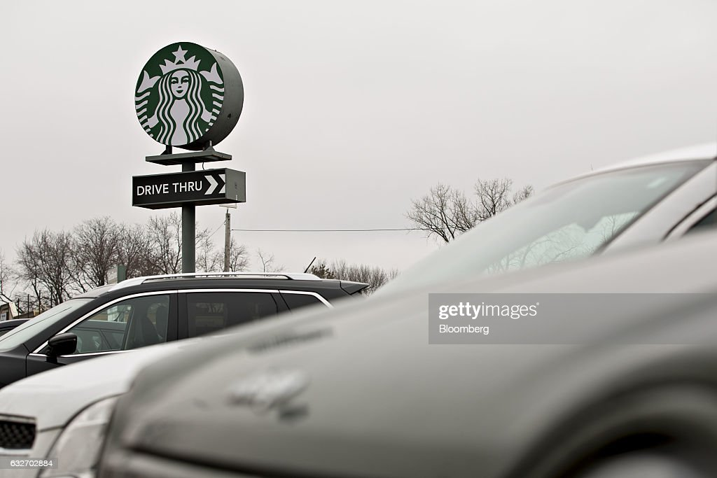 Signage is displayed outside a Starbucks Corp. coffee shop in Peoria, Illinois, U.S., on Wednesday, Jan. 25, 2017. Starbucks Corp. is expected to release earnings figures on January 26. Photographer: Daniel Acker/Bloomberg via Getty Images