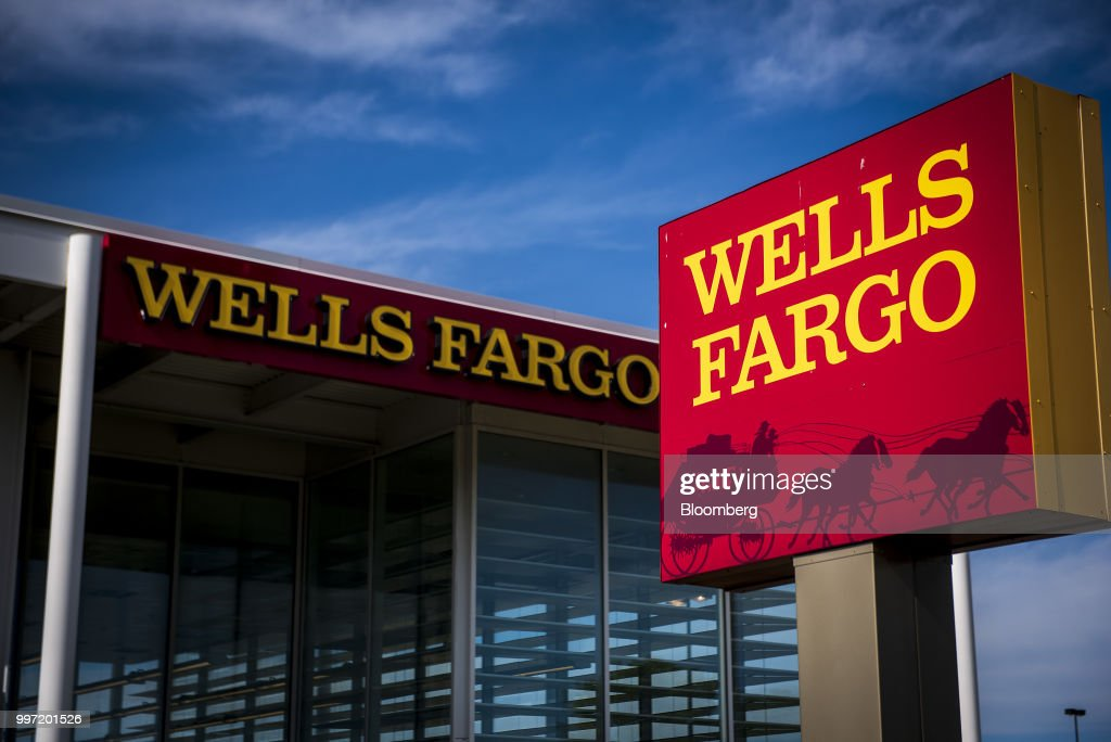 Signage is displayed outside a Wells Fargo & Co. bank branch in Niles, Illinois, U.S., on Tuesday, July 10, 2018. Wells Fargo & Co. is scheduled to release earnings figures on July 13. Photographer: Christopher Dilts/Bloomberg via Getty Images