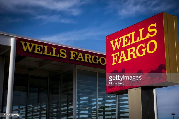 Signage is displayed outside a Wells Fargo Co bank branch in Niles Illinois US on Tuesday July 10 2018 Wells Fargo Co is scheduled to release...