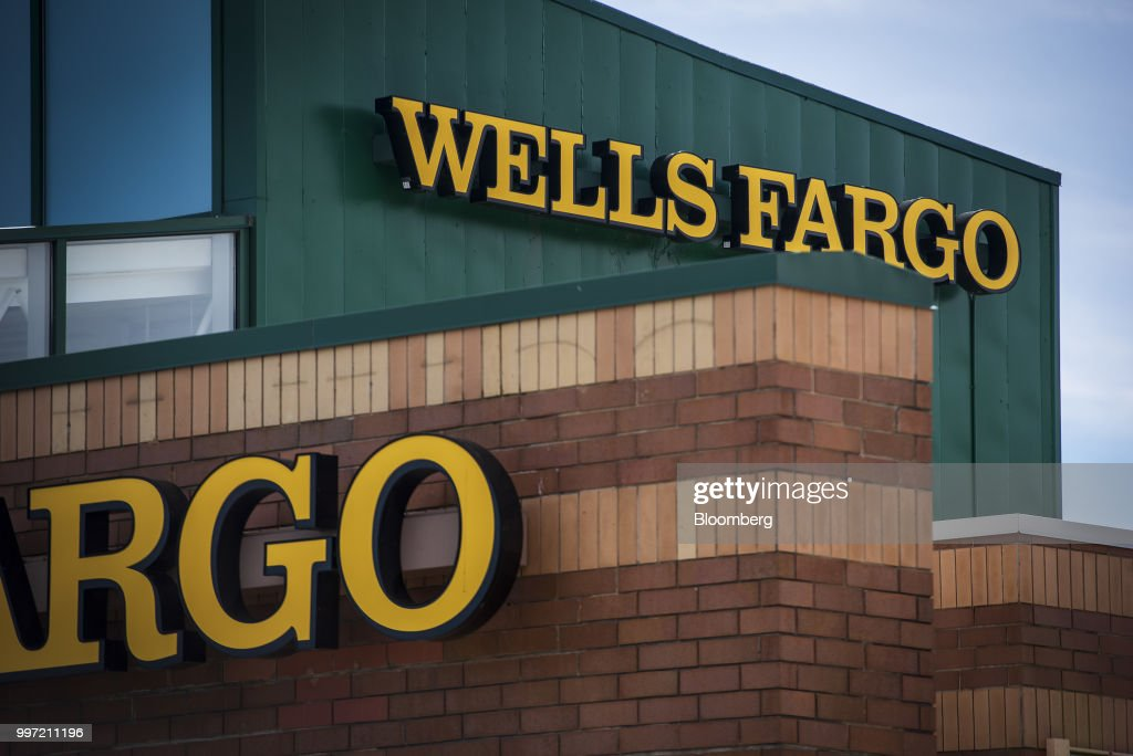 Signage is displayed outside a Wells Fargo & Co. bank branch in Palatine, Illinois, U.S., on Tuesday, July 10, 2018. Wells Fargo & Co. is scheduled to release earnings figures on July 13. Photographer: Christopher Dilts/Bloomberg via Getty Images