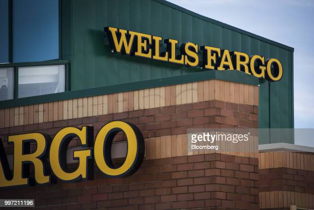 Signage is displayed outside a Wells Fargo Co bank branch in Palatine Illinois US on Tuesday July 10 2018 Wells Fargo Co is scheduled to release...