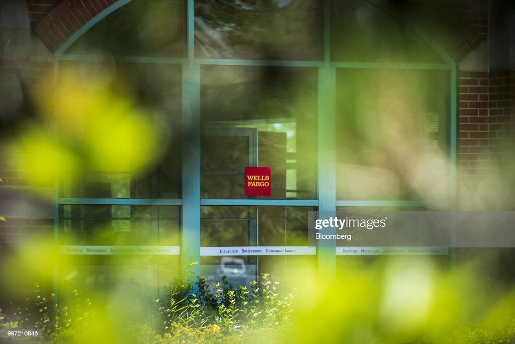 Signage is displayed outside a Wells Fargo & Co. bank branch in Schaumburg, Illinois, U.S., on Tuesday, July 10, 2018. Wells Fargo & Co. is scheduled to release earnings figures on July 13. Photographer: Christopher Dilts/Bloomberg via Getty Images