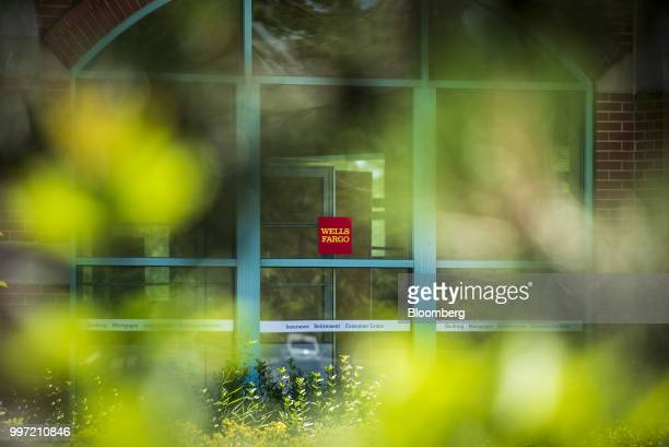 Signage is displayed outside a Wells Fargo Co bank branch in Schaumburg Illinois US on Tuesday July 10 2018 Wells Fargo Co is scheduled to release...