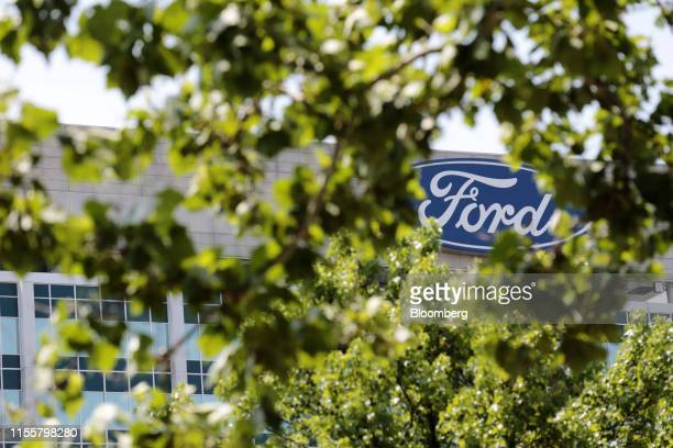 Signage is displayed outside Ford Motor Co. Headquarters in Dearborn, Michigan, U.S., on Monday, July 15, 2019. Negotiations between the United Auto...