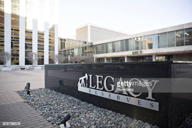 Signage is displayed outside Legacy Reserves LP headquarters in Midland Texas US on Thursday March 1 2018 Chevron the world's thirdlargest publicly...