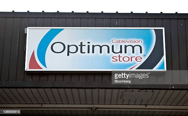 Signage is displayed outside of a Cablevision Systems Corp Optimum store in the Brooklyn borough of New York US on Thursday Nov 18 2010 Cablevision...