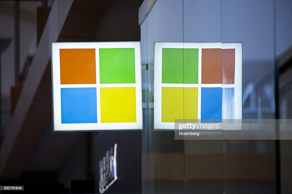 Signage is displayed outside of a Microsoft Corp. store in Bellevue, Washington, U.S., on Thursday, Jan. 26, 2017. Microsoft Corp.'s second-quarter sales and profit exceeded analysts' projections, bolstered by rising customer sign-ups for Azure and Office cloud-computing services. Photographer: David Ryder/Bloomberg via Getty Images