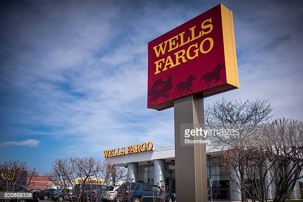 Signage is displayed outside of a Wells Fargo Co bank branch in Evanston Illinois US on Monday April 11 2016 Wells Fargo Co is scheduled to release...