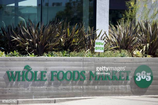 Signage is displayed outside of a Whole Foods Market 365 location during the grand opening in Santa Monica California US on Wednesday Aug 9 2017 The...