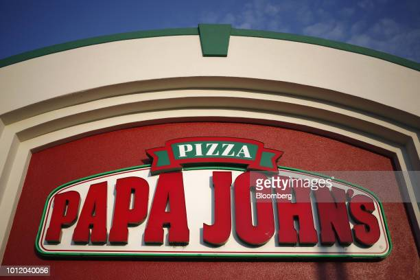 Signage is displayed outside Papa John's International Inc pizza restaurant in Louisville Kentucky US on Friday Aug 3 2018 Papa John's International...