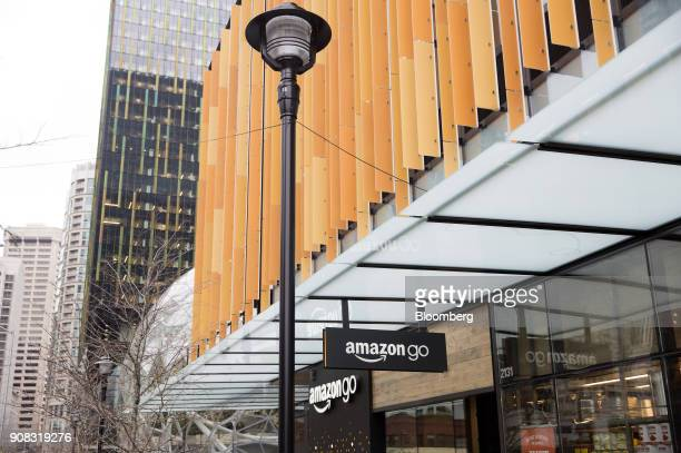 Signage is displayed outside the Amazon Go store in Seattle Washington US on Wednesday Jan 17 2018 After more than a year of testing with an...