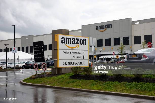 Signage is displayed outside the Amazon.com Inc. Facility in the Staten Island borough of New York, U.S., on Friday, May 1, 2020. Workers at Amazon,...