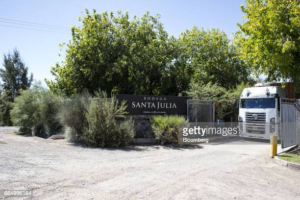 Signage is displayed outside the Bodega Santa Julia production facility in Mendoza Argentina on Tuesday March 23 2017 The Argentine wine industry is...