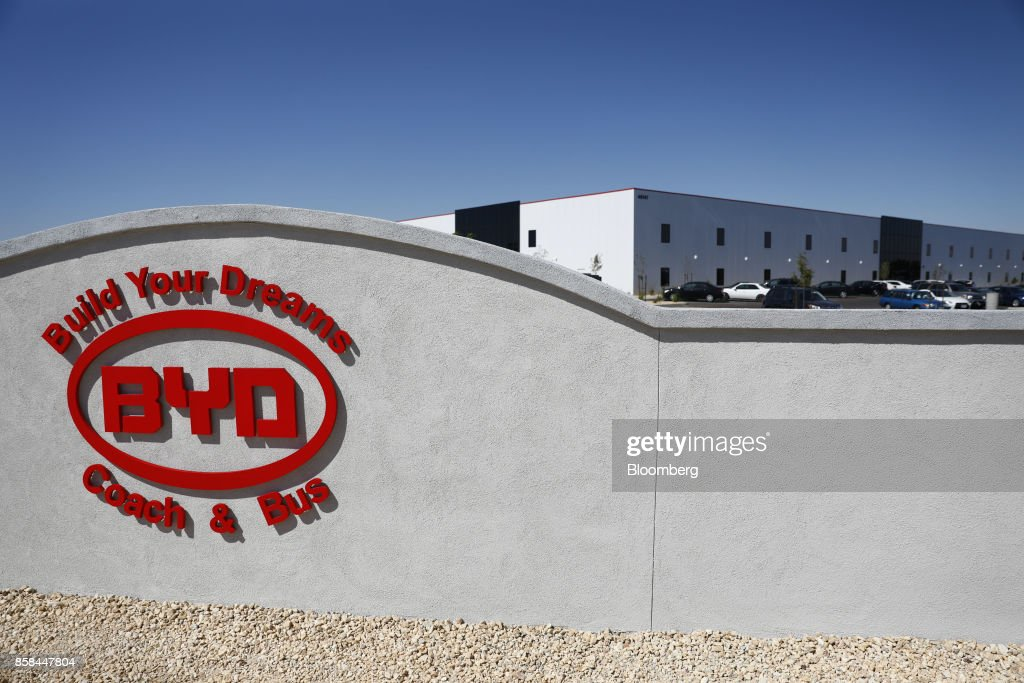 Signage is displayed outside the BYD Coach and Bus factory in Lancaster, California, U.S., on Thursday, Oct. 5, 2017. BYD unveiled the newly expanded 450,000 square foot factory on Friday, North America's largest electric bus manufacturing facility. Photographer: Patrick T. Fallon/Bloomberg via Getty Images