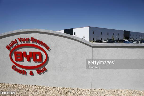 Signage is displayed outside the BYD Coach and Bus factory in Lancaster California US on Thursday Oct 5 2017 BYD unveiled the newly expanded 450000...