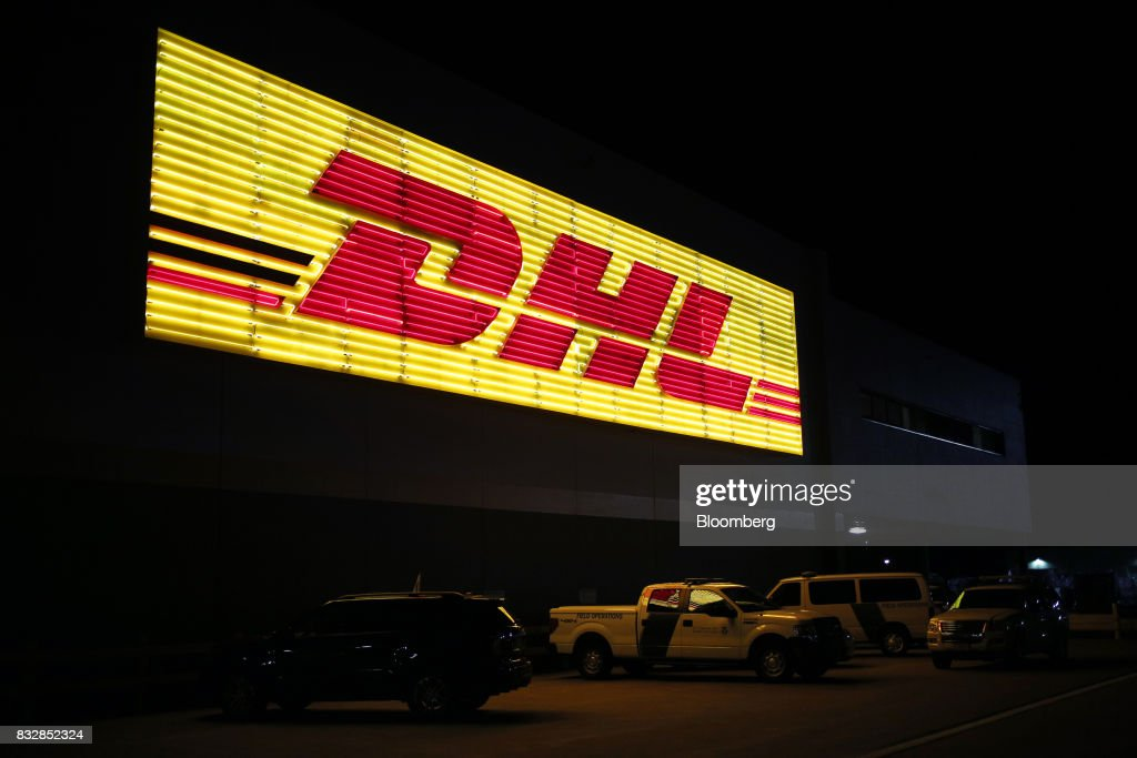 Signage is displayed outside the DHL Worldwide Express hub of Cincinnati/Northern Kentucky International Airport in Hebron, Kentucky, U.S., on Wednesday, Aug. 16, 2017. The Deutsche Post AG, parent company to Worldwide Express, second-quarter operating profit jumped 12 percent as the German mail operator handled more express deliveries and won more business at its logistics unit. Photographer: Luke Sharrett/Bloomberg via Getty Images
