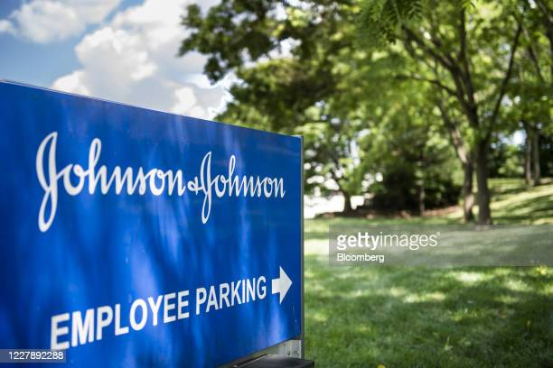 Signage is displayed outside the employee parking lot of Johnson & Johnson headquarters in New Brunswick, New Jersey, U.S., on Saturday, Aug. 1,...