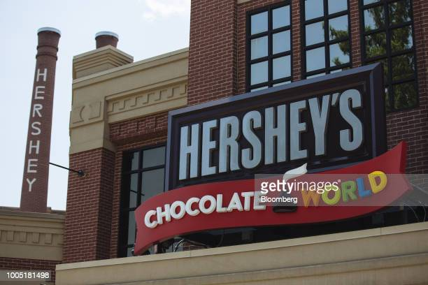 Signage is displayed outside the Hershey Co Chocolate World store in Hershey Pennsylvania US on Friday July 13 2018 Hershey Co is scheduled to...