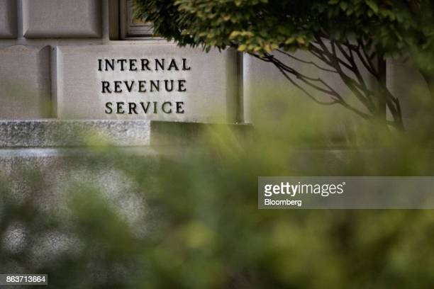 Signage is displayed outside the Internal Revenue Service headquarters in Washington DC US on Friday Oct 20 2017 President Donald Trump's top...