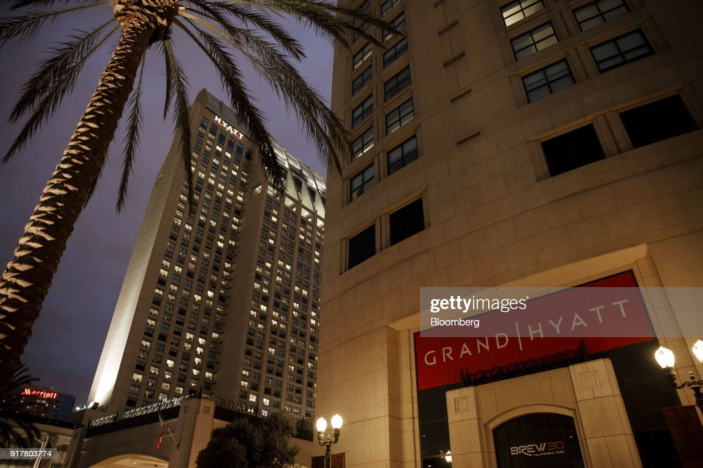Signage is displayed outside the Manchester Grand Hyatt Hotel at night in San Diego, California, U.S., on Sunday, Feb. 11, 2018. Hyatt Hotels Corp. is scheduled to release earnings figures on February 14. Photographer: Patrick T. Fallon/Bloomberg via Getty Images