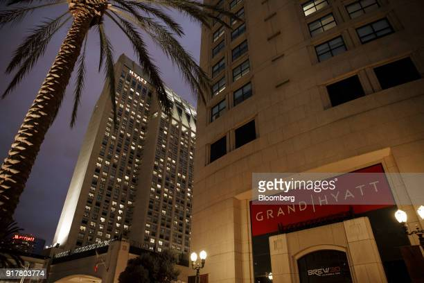 Signage is displayed outside the Manchester Grand Hyatt Hotel at night in San Diego California US on Sunday Feb 11 2018 Hyatt Hotels Corp is...