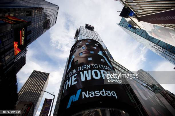 Signage is displayed outside the Nasdaq MarketSite in the Times Square neighborhood of New York US on Monday Dec 17 2018 Healthcare and technology...