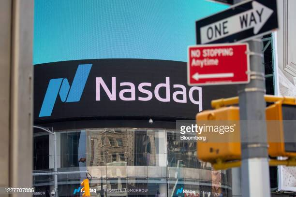 Signage is displayed outside the Nasdaq MarketSite in the Times Square neighborhood of New York US on Monday July 20 2020 US stocks fluctuated...