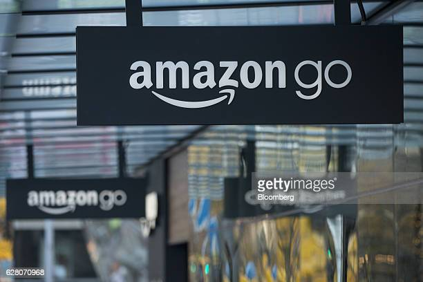 Signage is displayed outside the new Amazon Go grocery store in Seattle Washington US on Tuesday Dec 6 2016 Amazoncom Inc unveiled technology that...