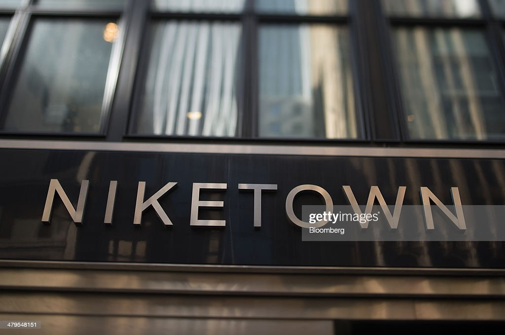 Signage Is Displayed Outside The Nike Inc Niketown Store In New York US On