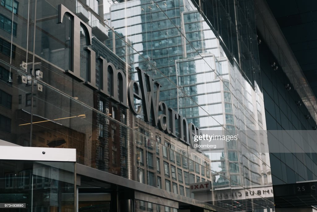 Signage is displayed outside the Time Warner Center in New York, U.S., on Wednesday, June 13, 2018. AT&T Inc.'s sweeping court victory allowing its takeover of Time Warner Inc. delivers a sharp setback to the Justice Department's new approach to policing mergers under President Donald Trump and promises to spark a merger wave across industries. Photographer: Christopher Lee/Bloomberg via Getty Images