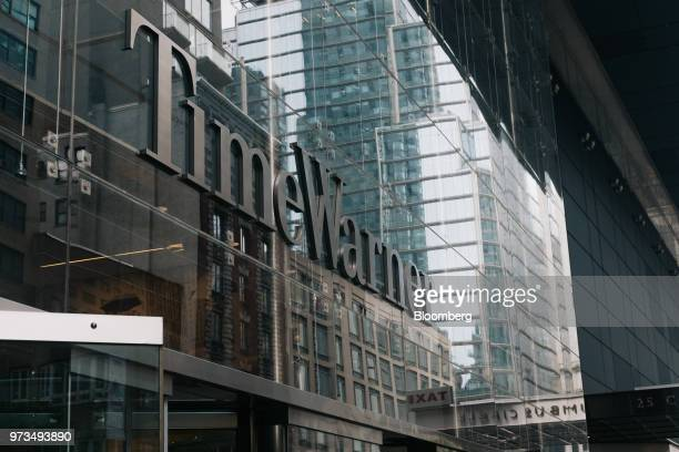 Signage is displayed outside the Time Warner Center in New York US on Wednesday June 13 2018 ATT Inc's sweeping court victory allowing its takeover...