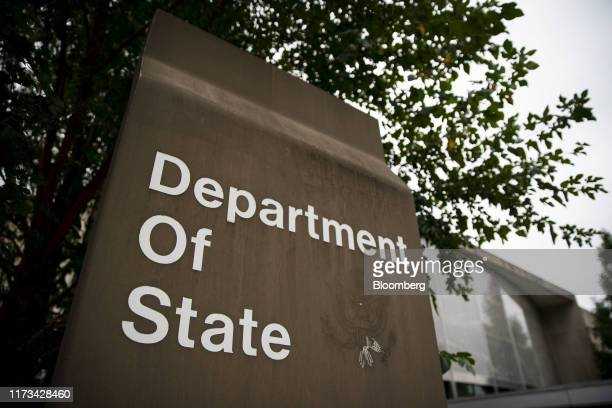 Signage is displayed outside the US State Department headquarters in Washington DC US on Thursday Oct 3 2019 Aides to Secretary of State Michael...